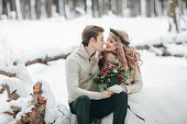 Beautiful couple in winter forest. Moment before a kiss.Artwork. Copy space