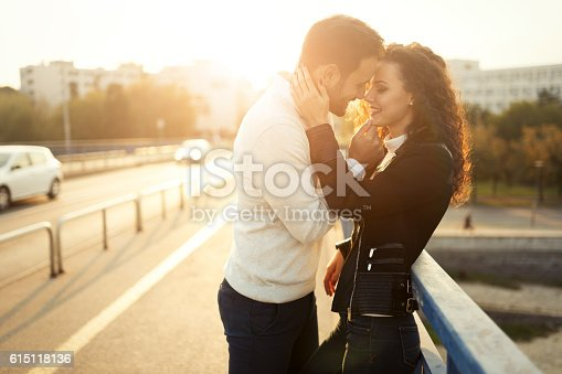 istock Beautiful couple kissing outdoors 615118136
