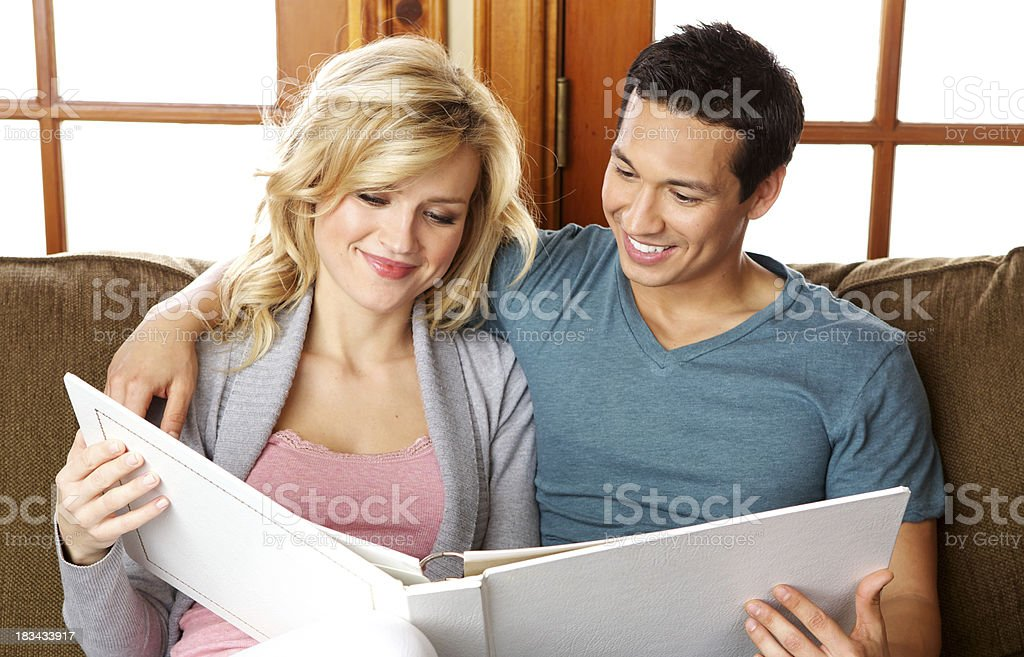 Beautiful Couple Looking at Their Wedding Album royalty-free stock photo