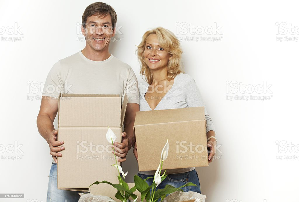 Beautiful couple moving into a new home and packing boxes. royalty-free stock photo