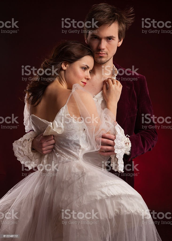 Beautiful couple of vampires dressed in medieval clothing. stock photo