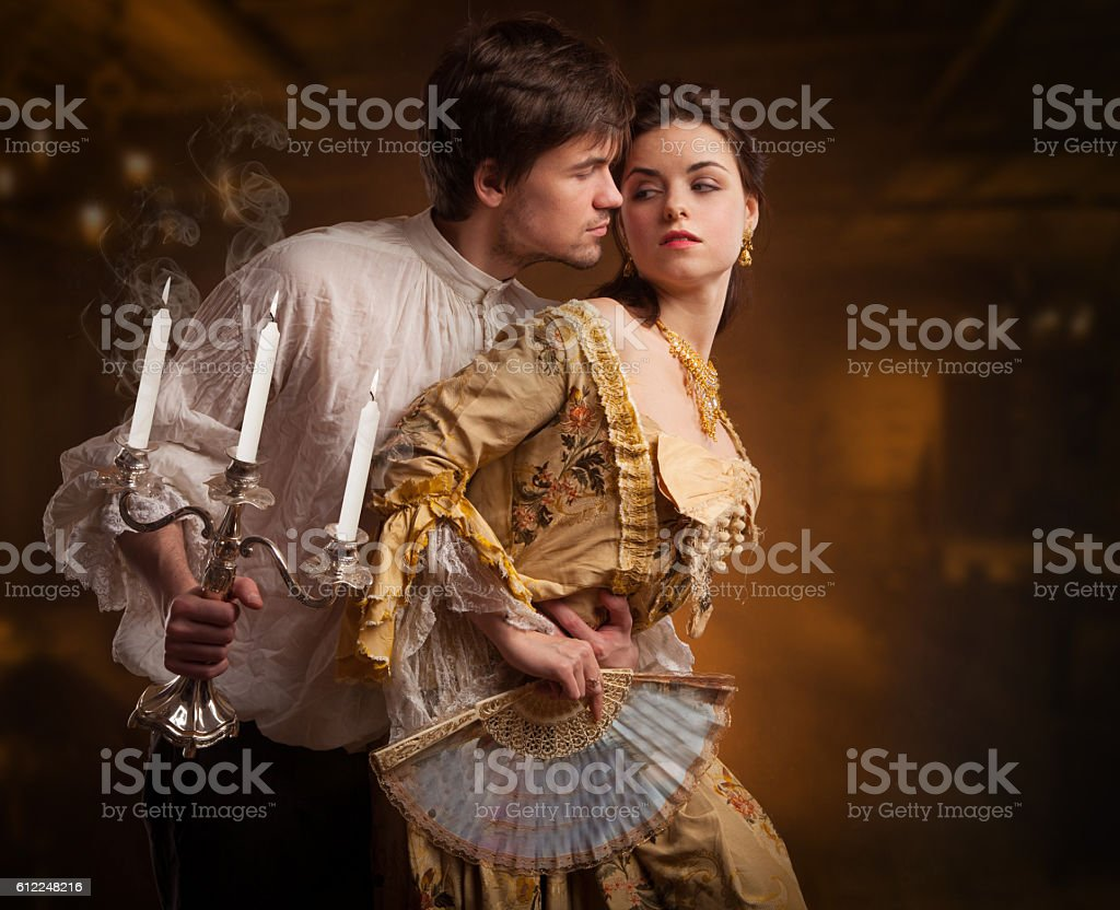 Beautiful couple of vampires dressed in medieval clothing. - Royalty-free Adult Stock Photo