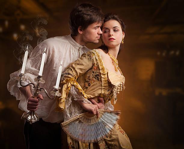 beautiful couple of vampires dressed in medieval clothing. - graf dracula stock-fotos und bilder