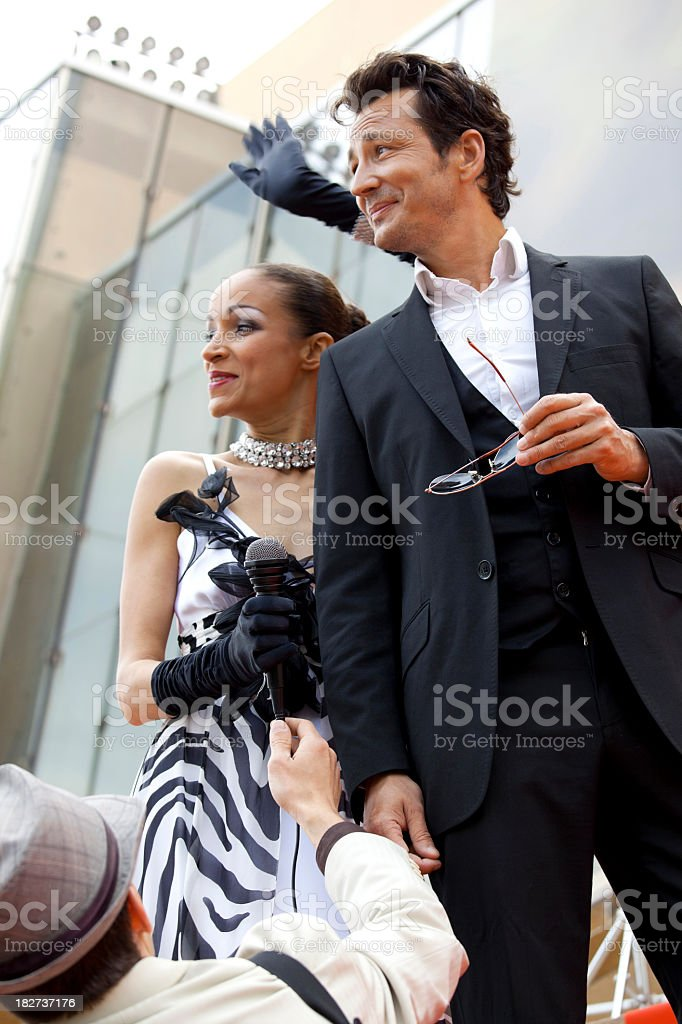Beautiful couple on red carpet royalty-free stock photo