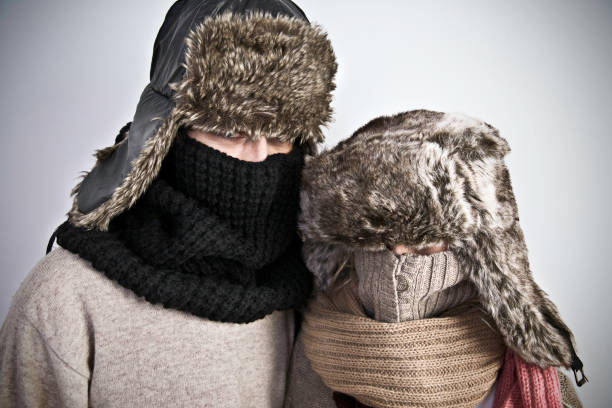 beautiful couple - warm clothing stock photos and pictures