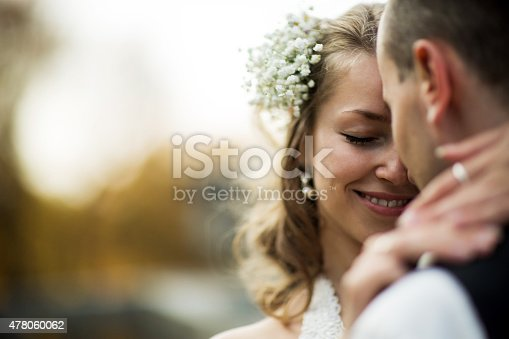 beautiful couple enjoying embrace of each other and tenderly smiling
