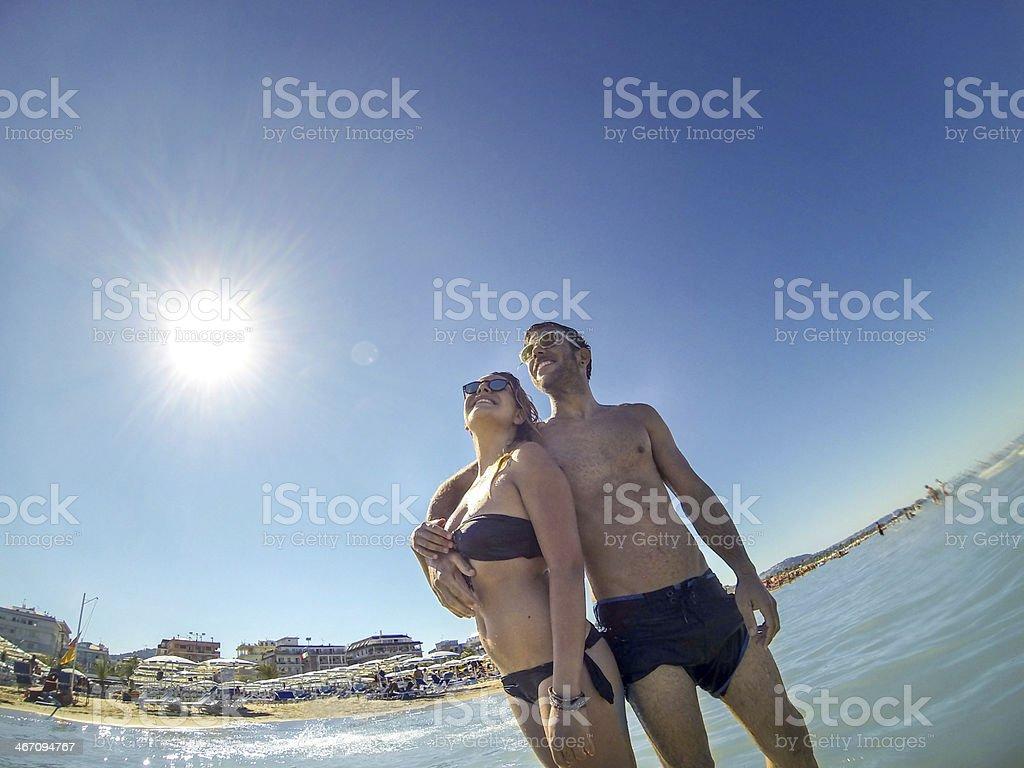 Beautiful couple posing on the beach royalty-free stock photo
