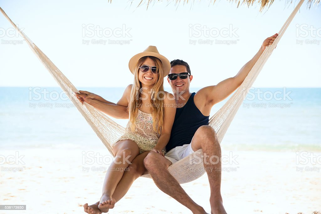 Beautiful couple relaxing in a hammock stock photo