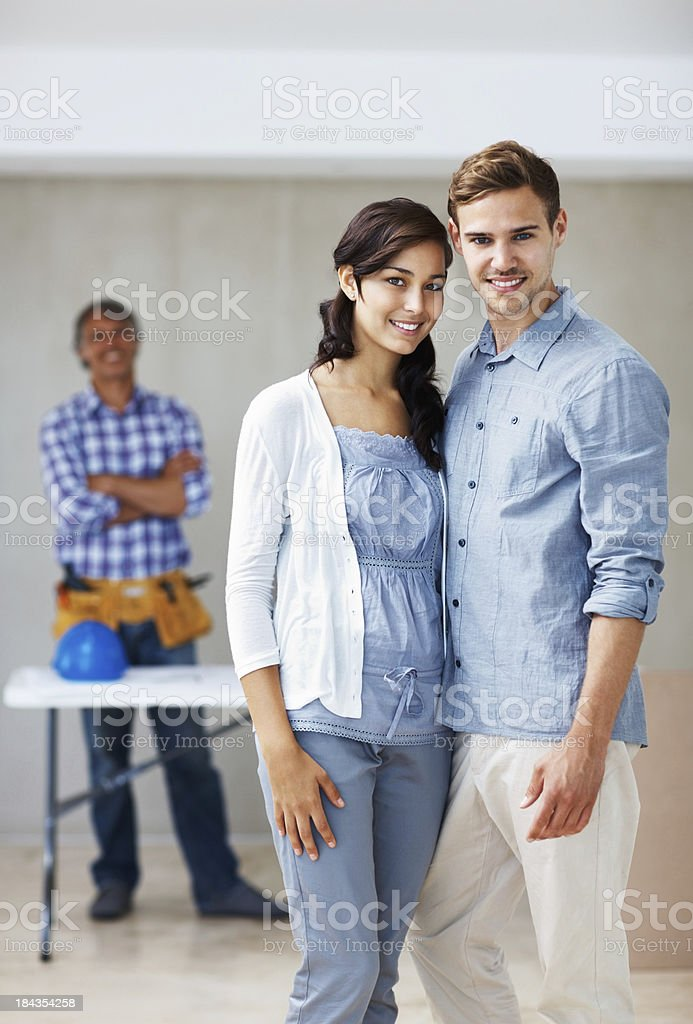 Beautiful couple renovating home royalty-free stock photo