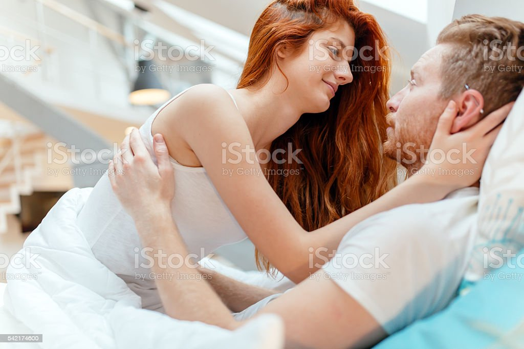 Beautiful couple romance in bed royalty free stock photo. Beautiful Couple Romance In Bed stock photo   iStock