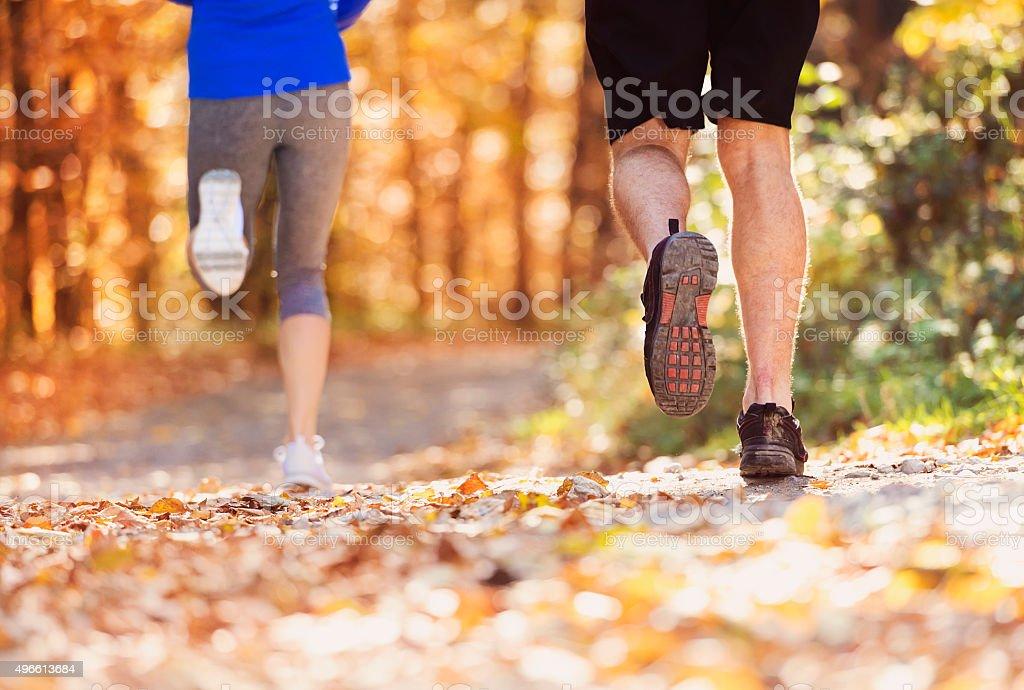 Beautiful couple running stock photo