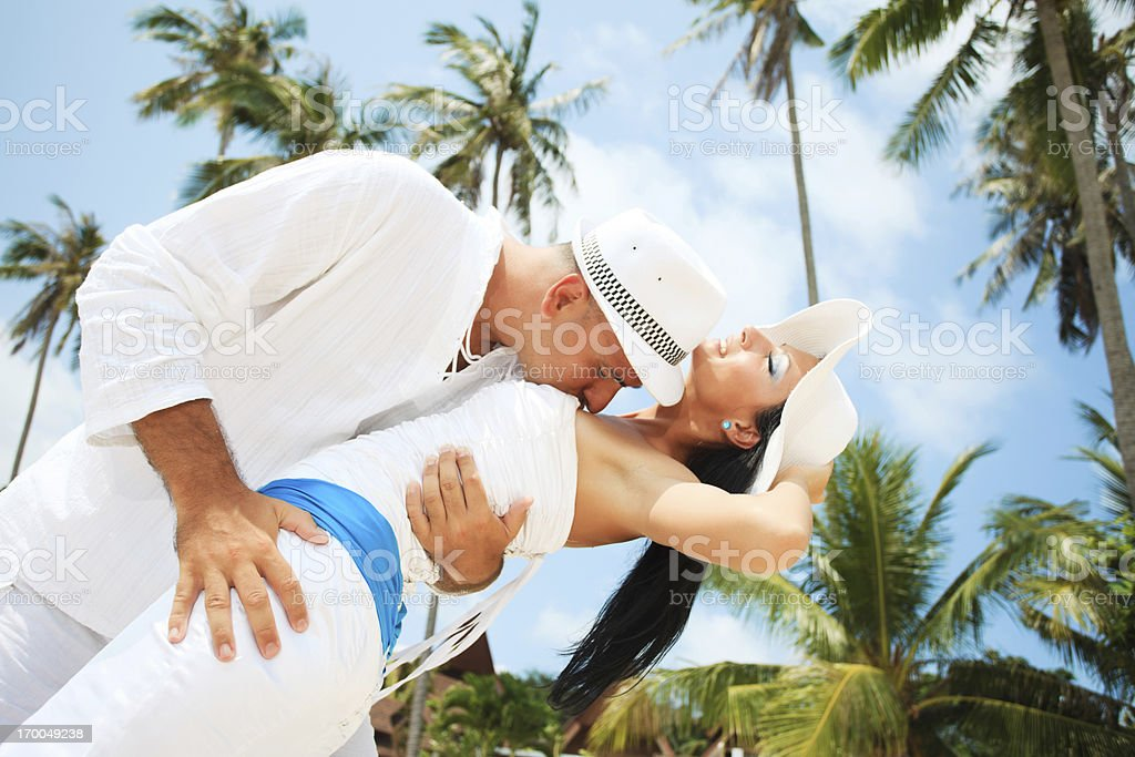 Beautiful couple showing affection on the beach. royalty-free stock photo