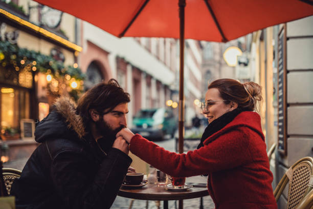 Beautiful couple sitting in the coffee bar outdoors in Germany Beautiful couple sitting in the coffee bar outdoors in Germany kissinghand stock pictures, royalty-free photos & images