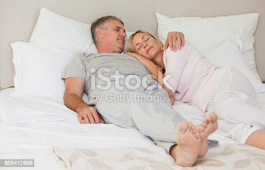 istock Beautiful couple sleeping on their bed 855412668
