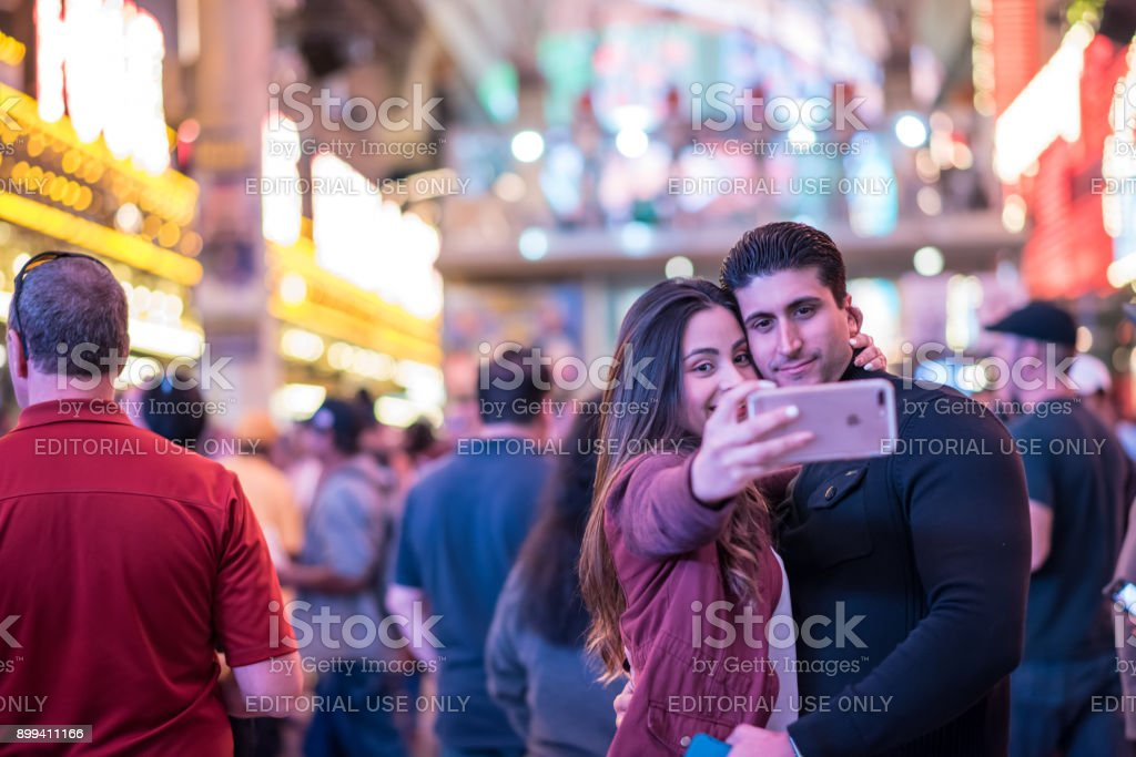 Beautiful couple taking a selfie at Fremont Street Experience, downtown Las Vegas stock photo