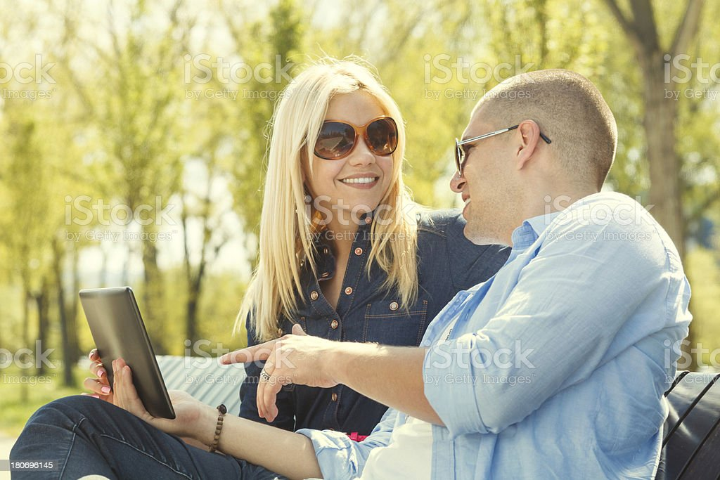 Beautiful couple using a digital tablet royalty-free stock photo