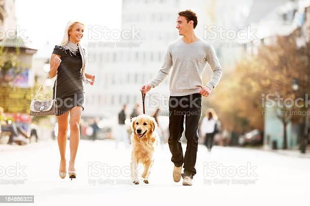 Beautiful couple walking the dog picture id184886322?b=1&k=6&m=184886322&s=612x612&h=qnz e4cotut1vbi60thuiwgf6aocww8lomfwhh lhpu=