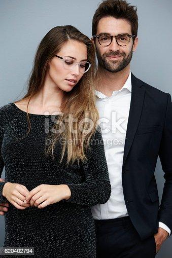 620404536istockphoto Beautiful couple wearing glasses, portrait 620402794