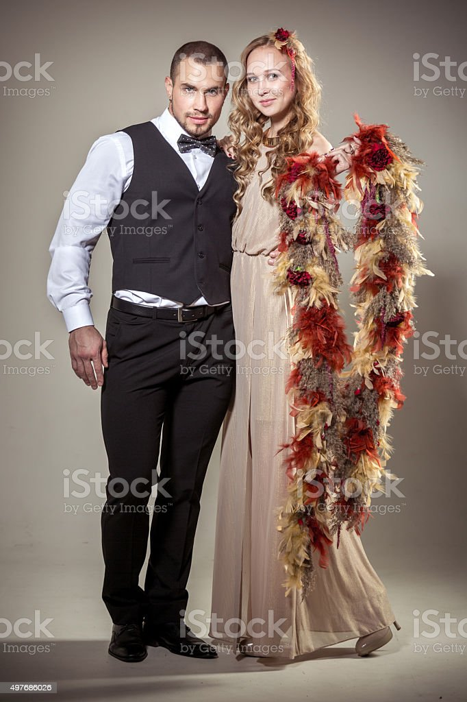 Beautiful Couple With Floral Arrangement stock photo