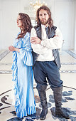 istock Beautiful couple woman and man in medieval clothes 487060610