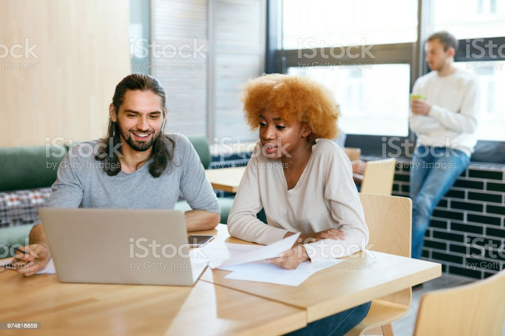 Beautiful Couple Working On Notebook In Cafe Stock Photo Download Image Now Istock
