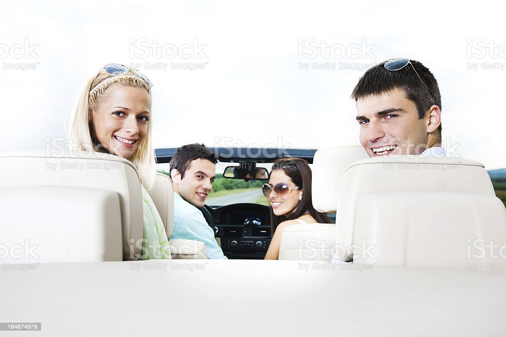Beautiful couples sitting in cabriolet car. royalty-free stock photo