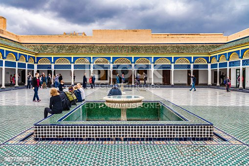 Beautiful courtyard at the Bahia Palace in Marrakech. Photo contains tourists visiting the historic site.