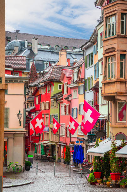 Beautiful cozy street in the city center of Zurich, Switzerland Beautiful cozy street in the city center of Zurich, Switzerland limmat river stock pictures, royalty-free photos & images
