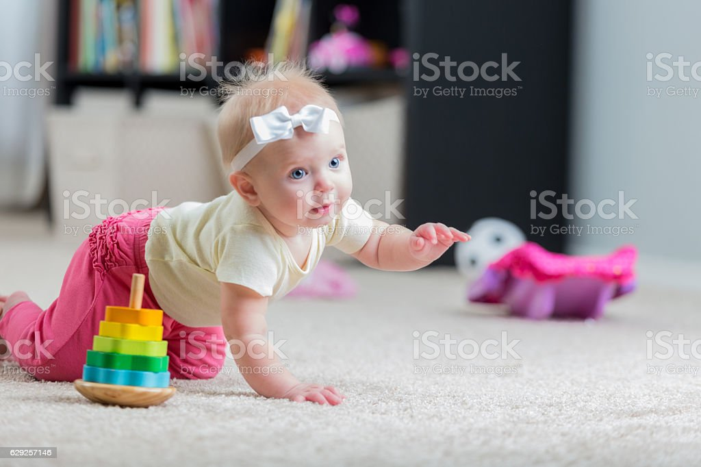 Beautiful crawling baby girl stock photo
