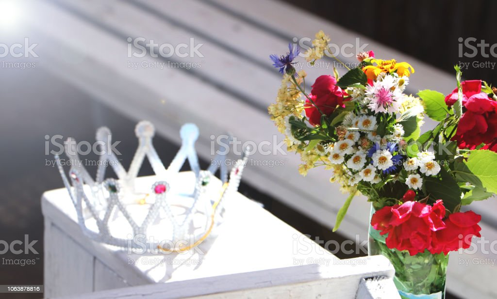 Beautiful crown and wild flowers. The concept of a bachelorette party or birthday stock photo