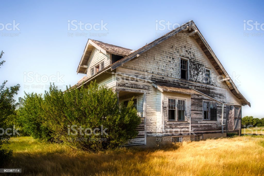 Beautiful crumbling two story farm house stock photo