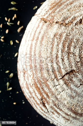 istock Beautiful crusty artisan bread on black background, top view 857808694