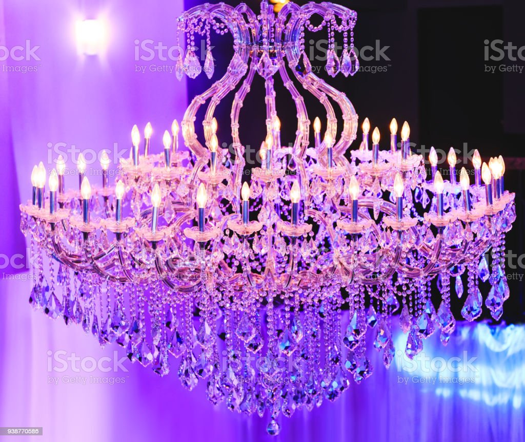 Beautiful crystal chandelier close up on the crystal of a beautiful crystal chandelier close up on the crystal of a contemporary crystal decoration luxury aloadofball Gallery