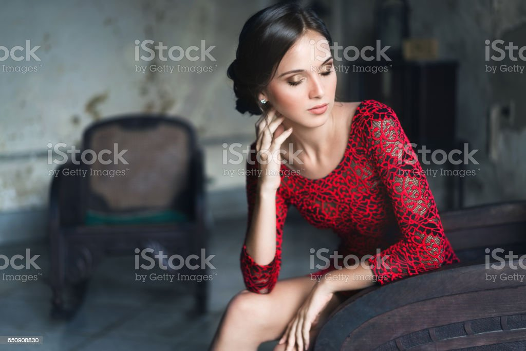 Beautiful cuban woman sitting with eyes closed on armchair stock photo