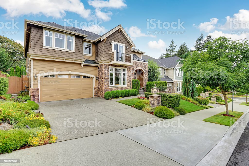 Beautiful curb appeal of American house with stone trim royalty-free stock photo