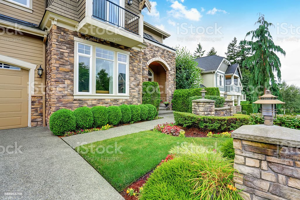 Beautiful curb appeal of American house with stone trim stock photo