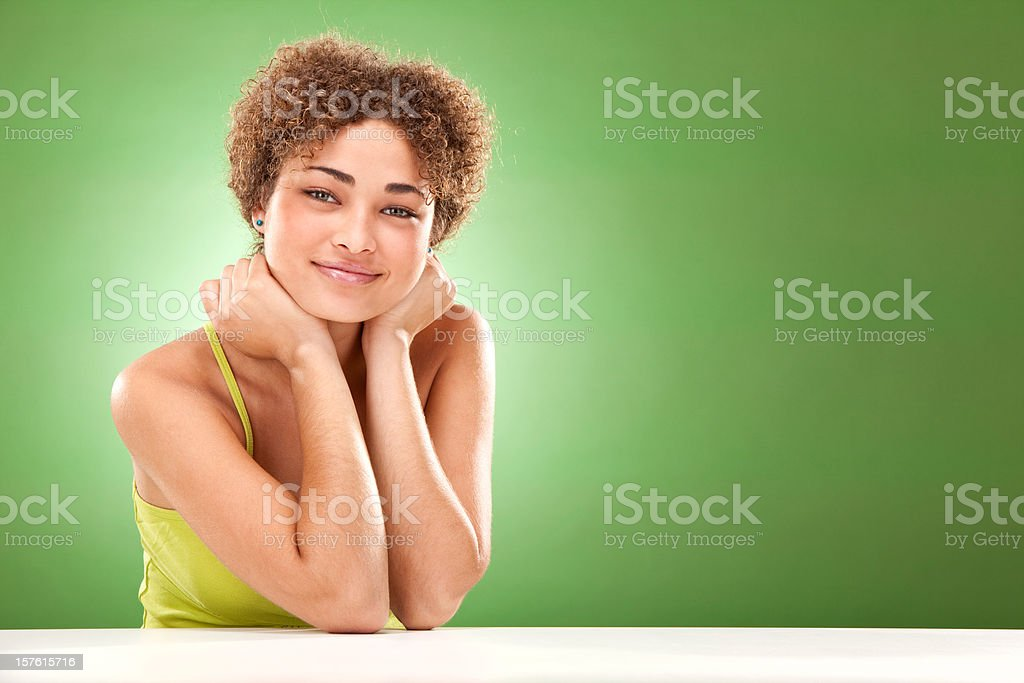 beautiful curly african casual girl smile lean  green background royalty-free stock photo
