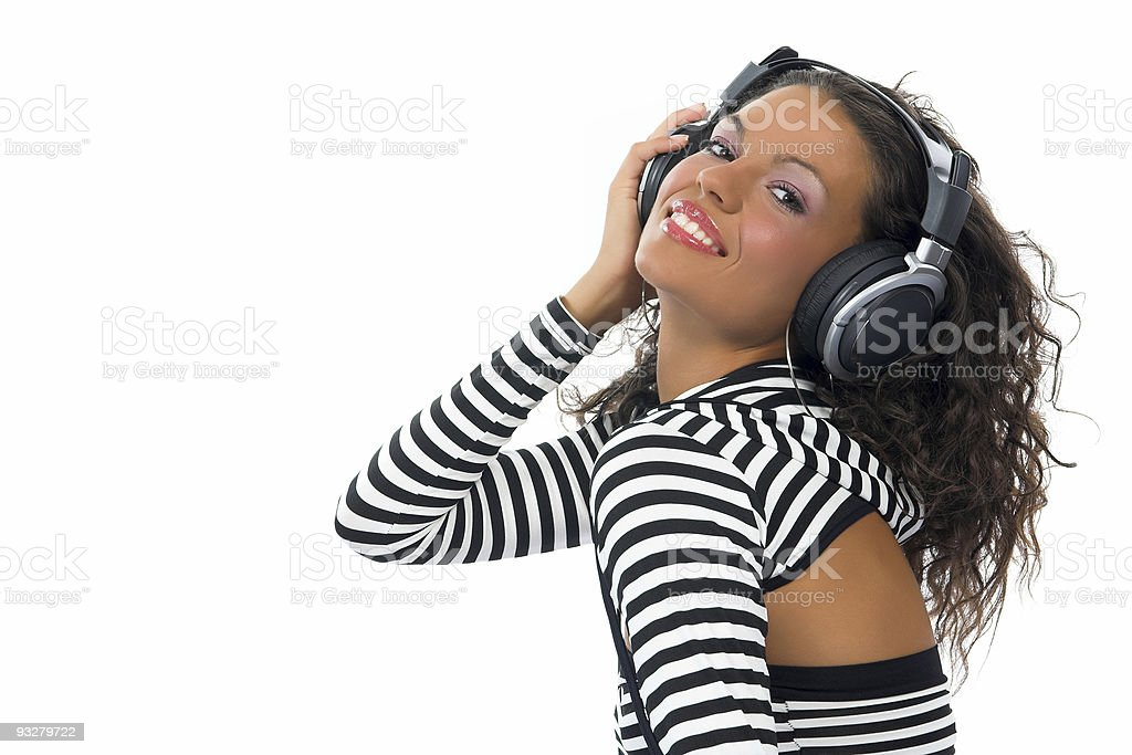 Beautiful curly brunette girl listening music royalty-free stock photo
