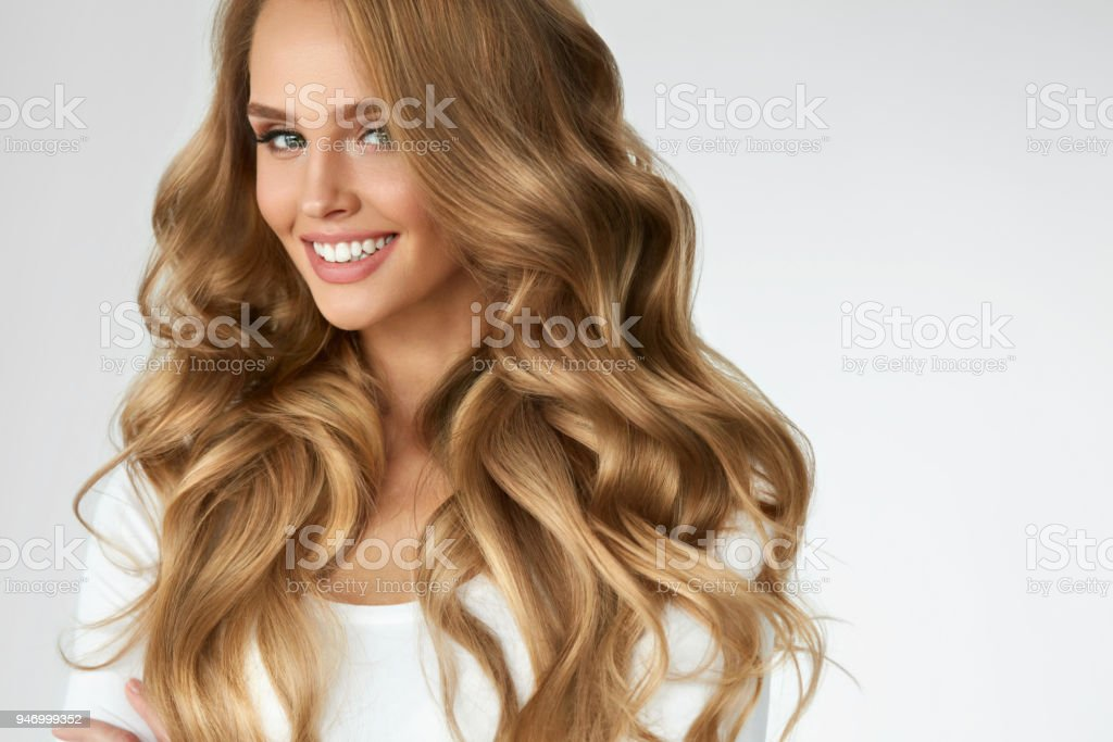 Beautiful Curly Hair. Girl With Wavy Long Hair Portrait. Volume royalty-free stock photo