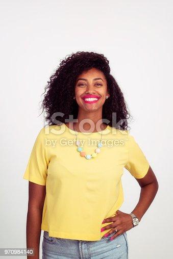 910856488 istock photo Beautiful curly hair woman posing. 970984140