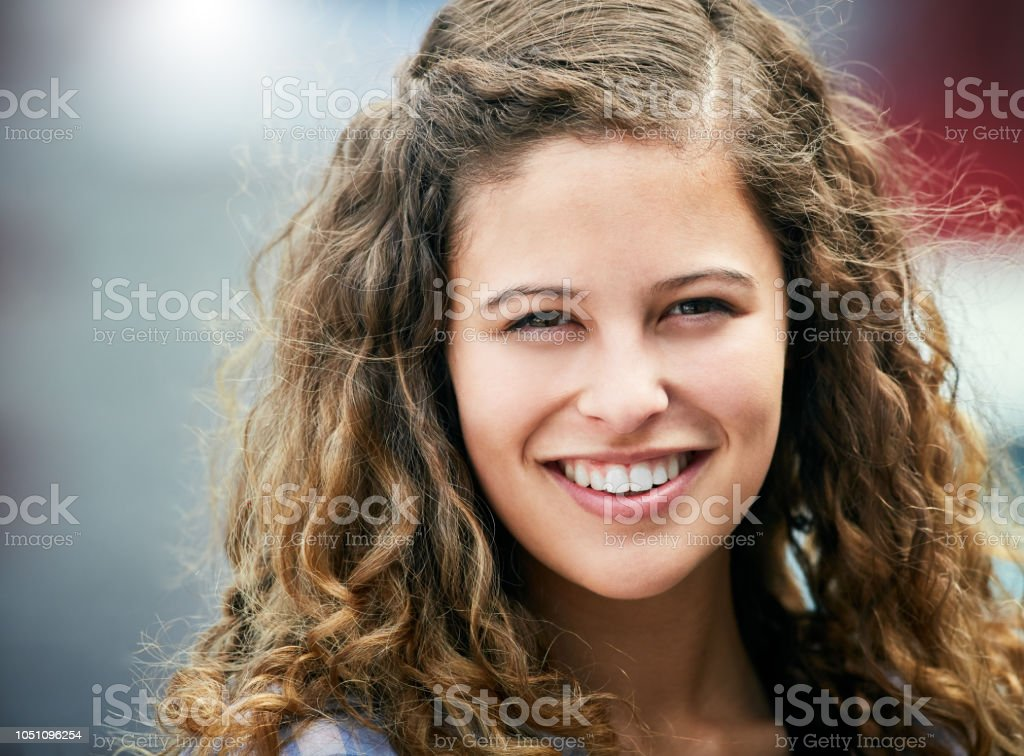 Beautiful Curlyhaired Teenage Girl Smiles For You Stock Photo Download Image Now Istock