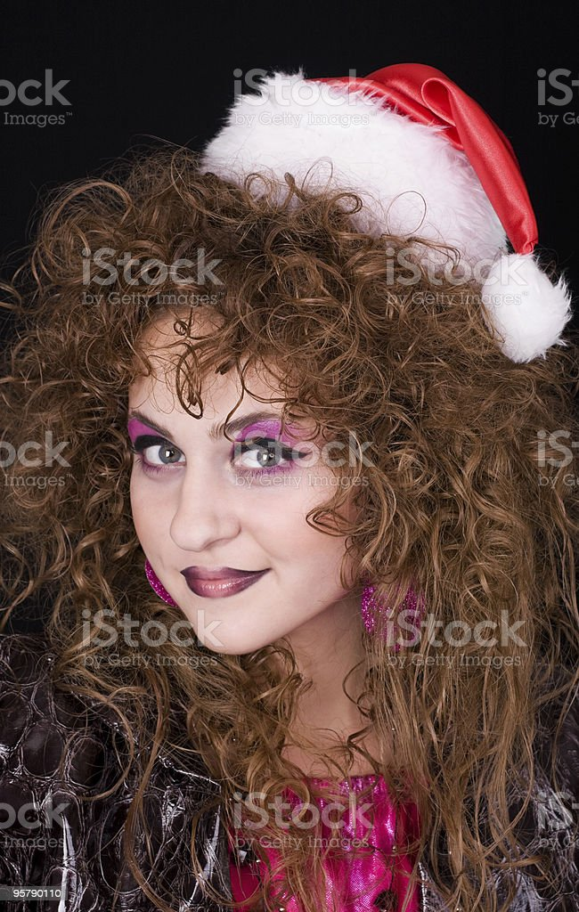 Beautiful curly-headed Santa-girl stock photo