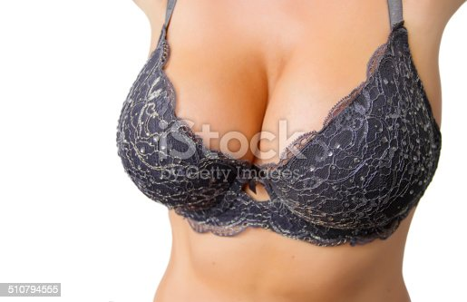 498310066istockphoto Beautiful curvy woman with big breasts in black bra 510794555