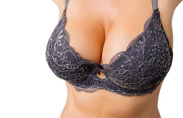 Beautiful curvy woman with big breasts in black bra stock photo