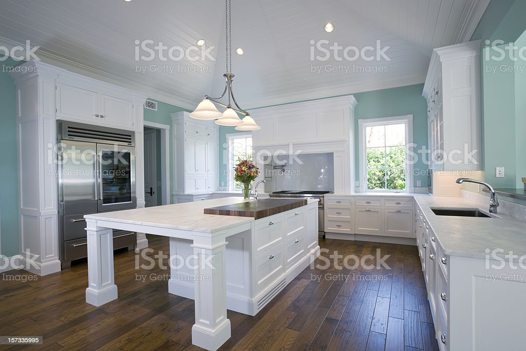 Beautiful Custom Built Kitchen Featuring Island in Estate Home stock photo