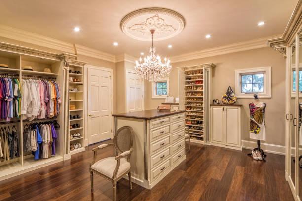 beautiful custom closet in an estate home - closet stock photos and pictures