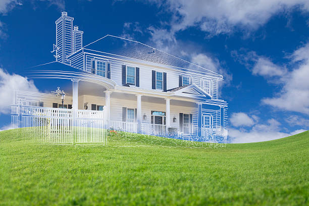 Beautiful Custom House Drawing and Ghosted House Above Grass stock photo