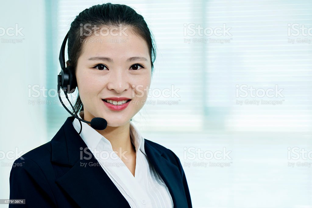 Beautiful customer service representative using headphones