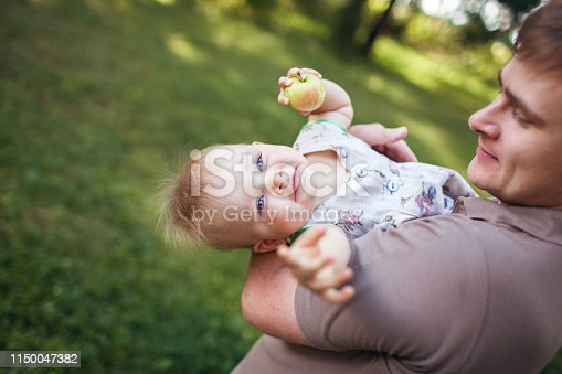istock beautiful cute girl in the arms of the daddy 1150047382