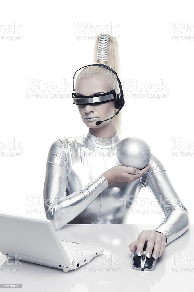 Beautiful cyber woman working on her laprop royalty-free stock photo